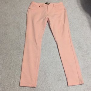 Peach colored skinny leg stretch pants